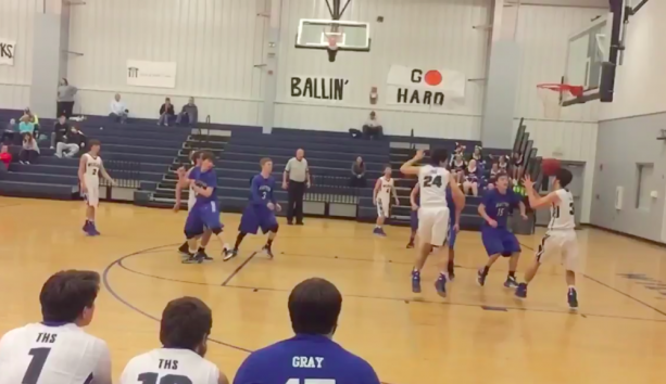 High school basketball player Makes a Header