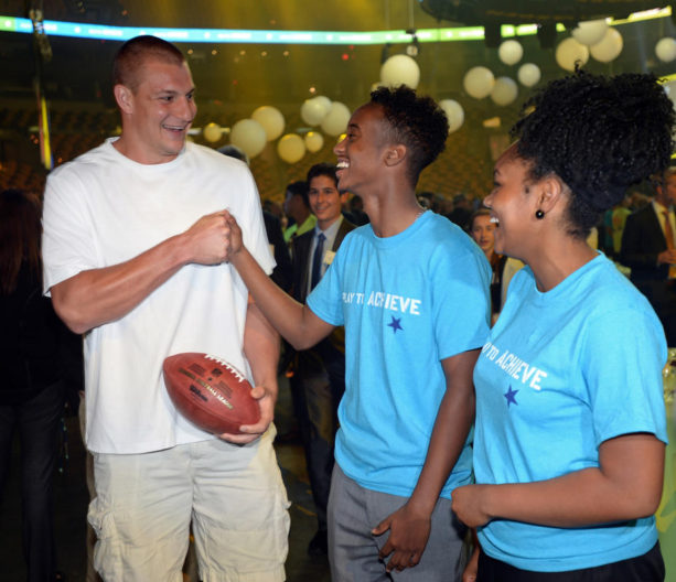 (Boston, MA, 06/22/16) New England Patriots' Rob Gronkowski, left, meets with Boston residents Yusuf Liban, center, and Simone McLaren, right, during the 2016 Scholar Athletes celebration at TD Garden on Wednesday, June 22, 2016. Liban and McLaren are alumni of the scholar athlete program. Staff photo by Christopher Evans