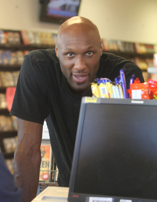 103680, LOS ANGELES, CALIFORNIA - Saturday August 31, 2013. Lamar Odom heads to a Blockbuster for some movies after getting some food to go in Los Angeles. Odom was arrested early yesterday morning for driving under the influence and refused to take a chemical test, resulting in the automatic suspension of his license. After arriving at his Encino home in a taxo cab this morning, he has been getting around in a chauffered car. Photograph: Miguel Aguilar, © PacificCoastNews.com **FEE MUST BE AGREED PRIOR TO USAGE** **E-TABLET/IPAD & MOBILE PHONE APP PUBLISHING REQUIRES ADDITIONAL FEES** LOS ANGELES OFFICE: +1 310 822 0419 LONDON OFFICE: +44 20 8090 4079